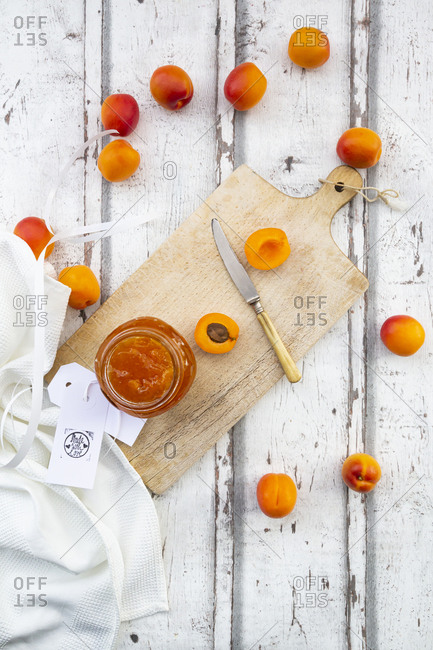 Directly above shot of apricot jam in jar on wooden table