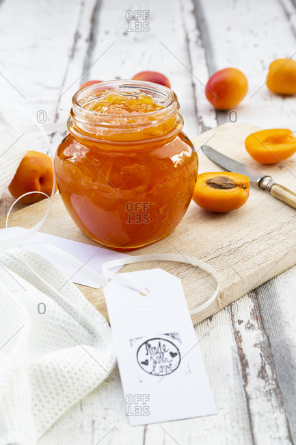High angle view of apricot jam in jar on wooden table