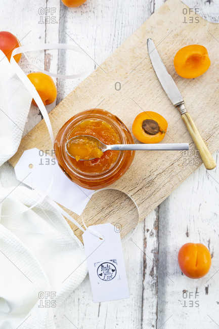 Directly above shot of apricot jam in jar on table