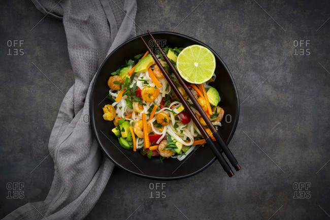 High angle view of cellophane noodles with shrimps and vegetables served in bowl on table