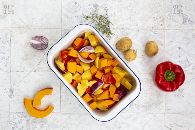 Autumn vegetables Hokkaido pumpkin- potatoes- peppers- red onions- thyme- feta