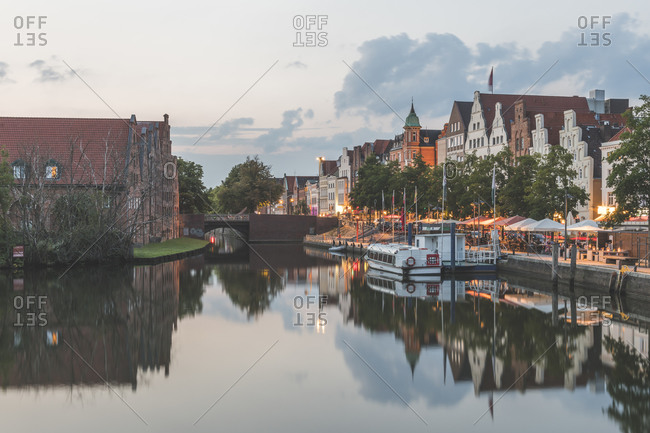 August 1, 2019: Ship moored by Travel River against sky during sunset- Lübeck- Germany