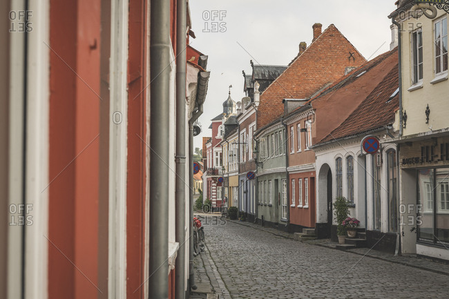 June 11, 2019: Denmark- Aeroe- Aeroskobing- Colorful traditional townhouses seen over empty street