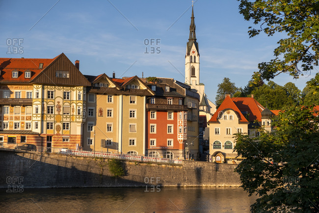July 11, 2019: Parish Church of the Assumption and buildings by River Isar in town- Bavaria- Germany