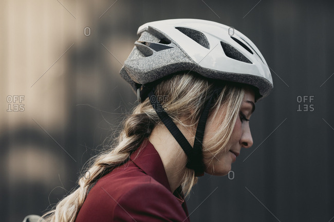Young woman wearing safety driving helmet.
