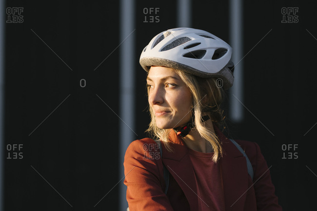 Portrait of beautiful young woman with safety driving helmet.