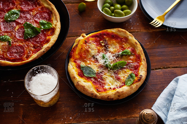 Rustic pizza on wooden table
