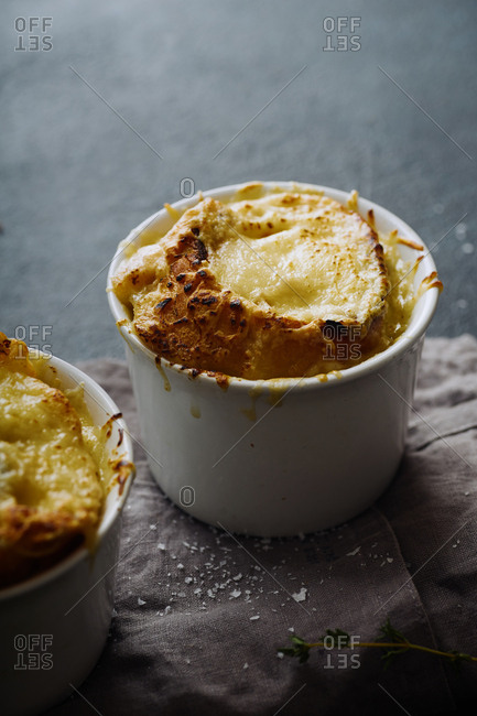 French onion soup with grilled baguette slices and melted gruyere cheese