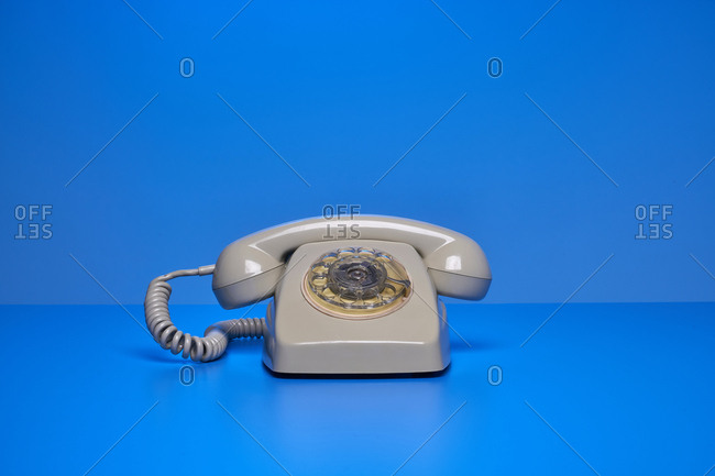 Vintage telephone on blue background