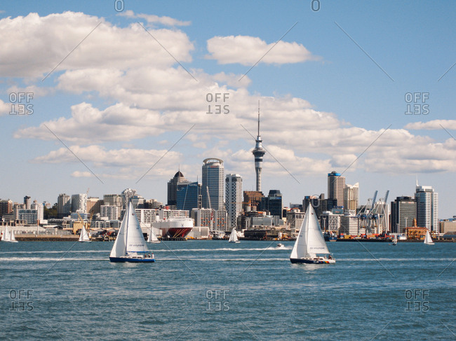 Auckland, New Zealand - April 10, 2010: Sailboats in the harbor in front of city