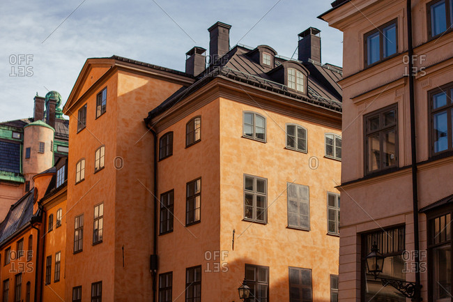 Stockholm, Sweden - March 23, 2012: Ochre colored buildings in downtown Stockholm