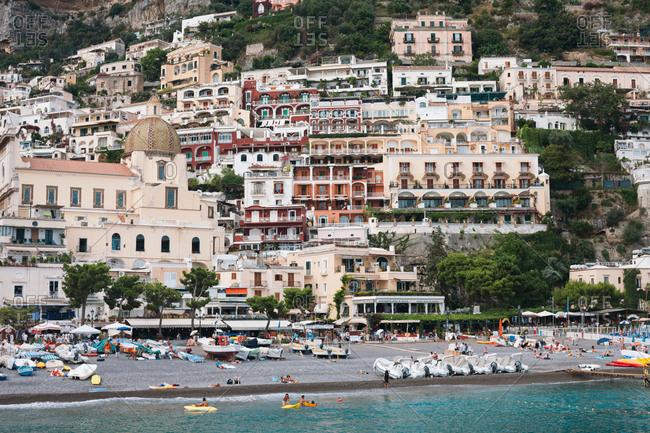 Positano, Italy - July 25, 2012: Beach at the resort town of Positano above the Tyrrhenian Sea on Italy's Amalfi Coast
