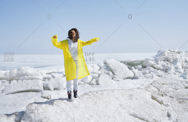 Young adult woman jumping outdoors