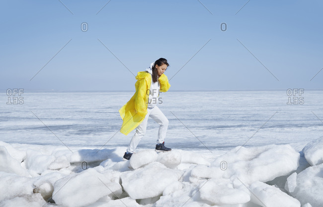 Young adult woman walking over ice
