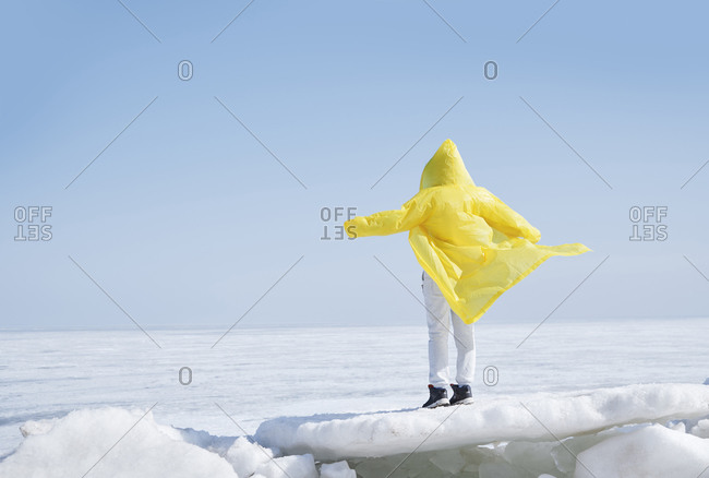 Young adult woman outdoors enjoying icy landscape