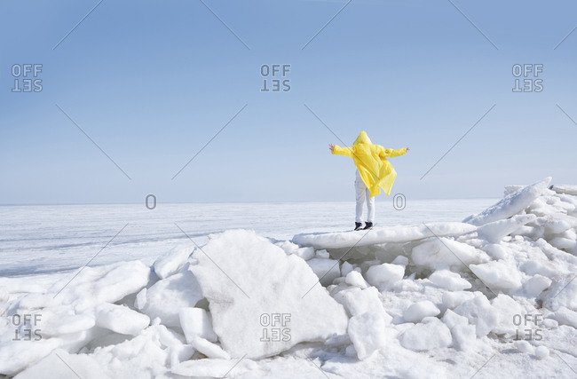 Young adult woman having fun on icy landscape