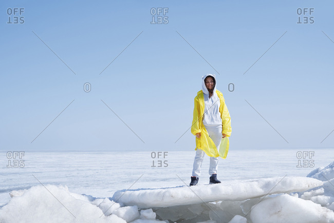 Young adult woman standing on ice