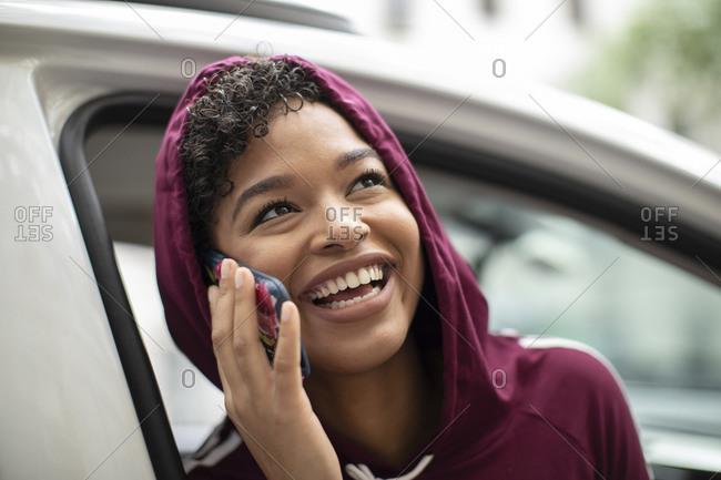 Cheerful Woman Talking On Smartphone