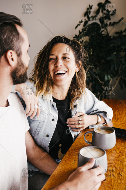 Cheerful Mid Adult Couple Enjoying At Cafe