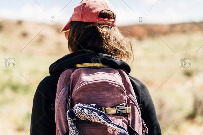 Female Backpacker Exploring Desert In Utah