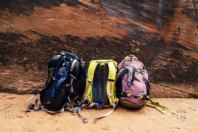 Backpacks Against Rock Formation At Desert