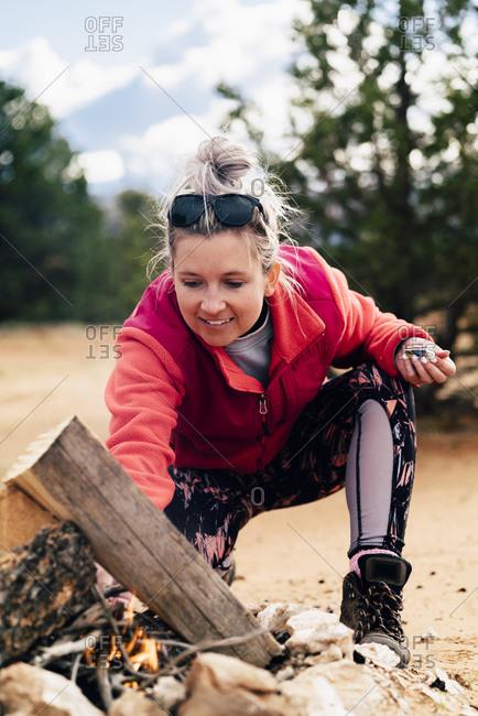 Woman Preparing Campfire At Campsite In Desert