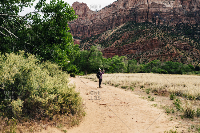 Hiker Exploring Mountains At Zion National Park
