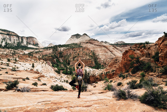 Hiker Practicing Yoga On Mountain At Zion National Park