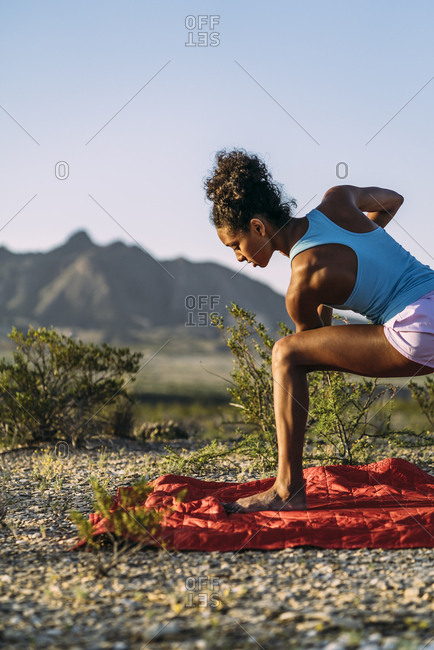 Woman Exercising On Field During Summer Vacation
