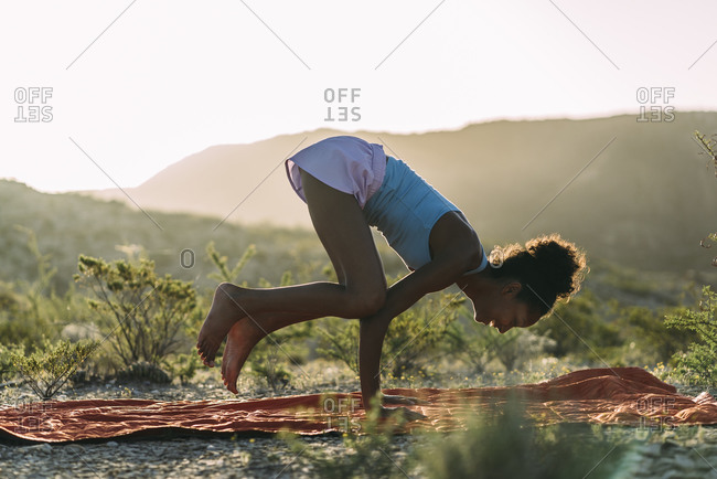 Woman Doing Handstand While Practicing Yoga During Summer
