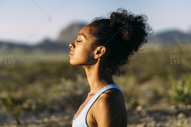 Woman Meditating With Closed Eyes On Summer Trip