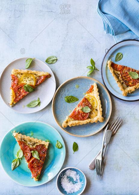 Vegetarian tomato tart on blue plates