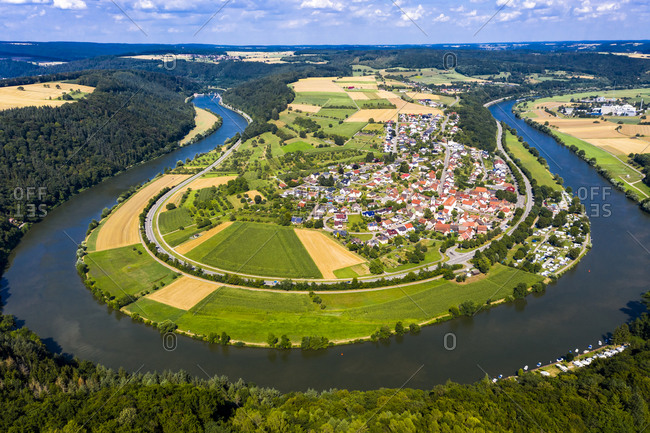 Germany- Bavaria- Binau- Aerial view of river curving around countryside town