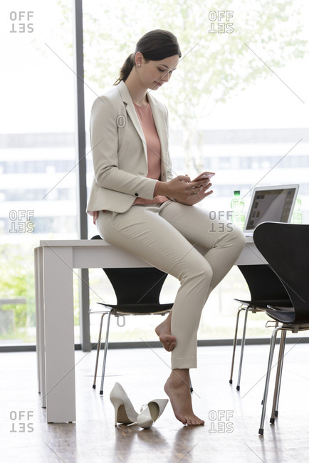 Young businesswoman using smartphone in office