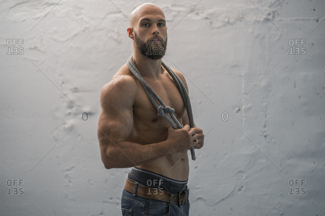 Portrait of a barechested athlete with rope