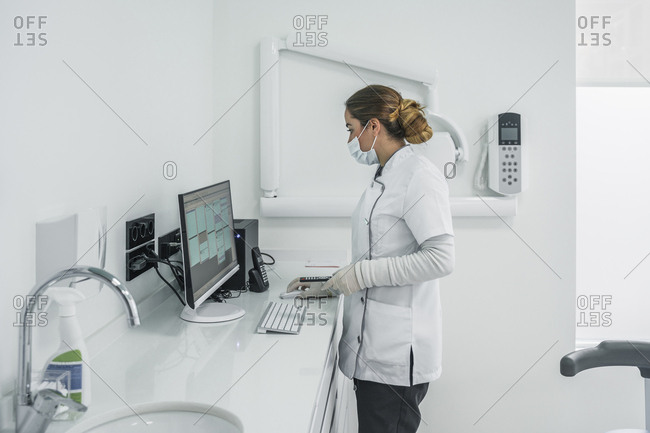 Female dentist working in dental clinic