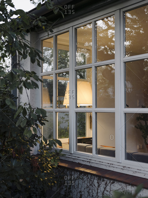 View into illuminated residential winter garden