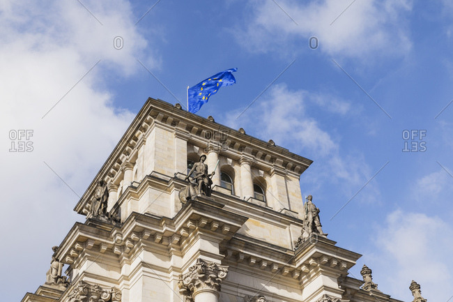 Germany- Berlin- European Union flag on top of Reichstag building