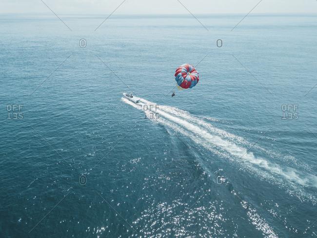 Nusa Dua- Bali- Nusa Dua- Aerial view of person parasailing and motorboat