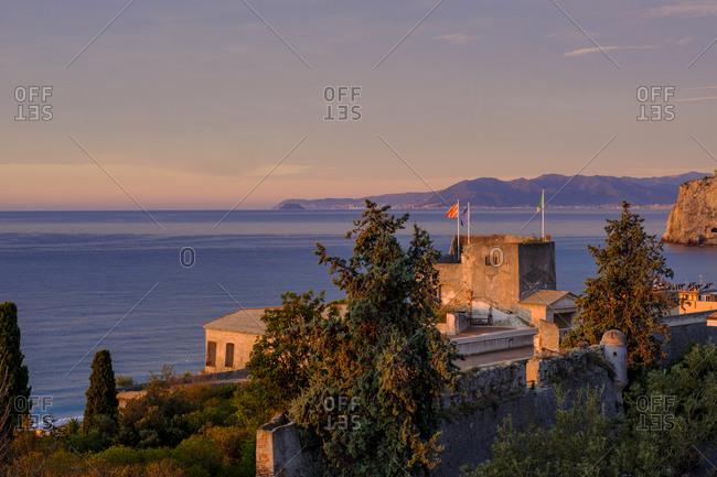 Italy- Liguria- Riviera di Ponente- Finale Ligure- La Fortezza and sea at sunrise