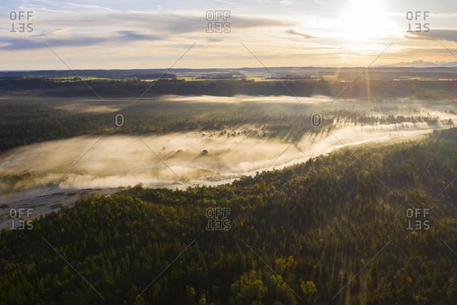 Germany- Bavaria- Wolfratshausen- Fog floating over Isar river at scenic sunrise