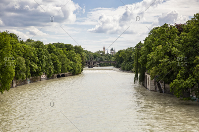 View of Isar river with Mullersches Volksbad in background- Munich- Bavaria- Germany