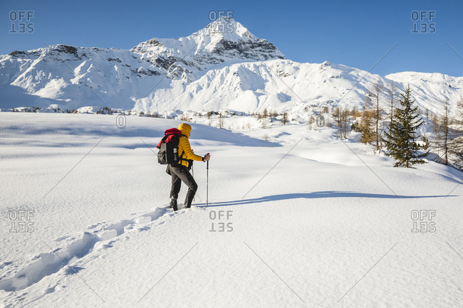 Hiking with snowshoes in the mountains- Valmalenco- Sondrio- Italy