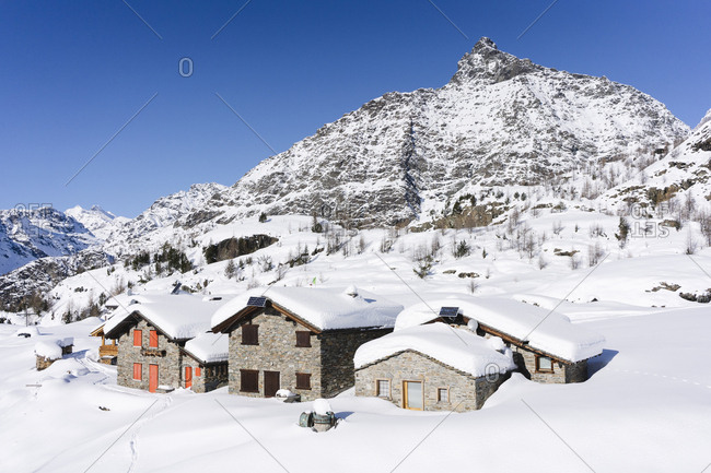 Mountain huts covered with fresh snow- Valmalenco- Italy