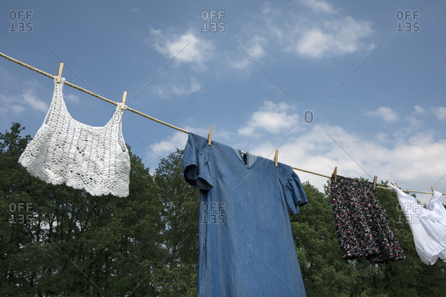Laundry drying on clothesline in nature