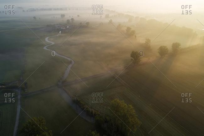 Germany- Bavaria- Aerial view of morning fog shrouding Aisch river