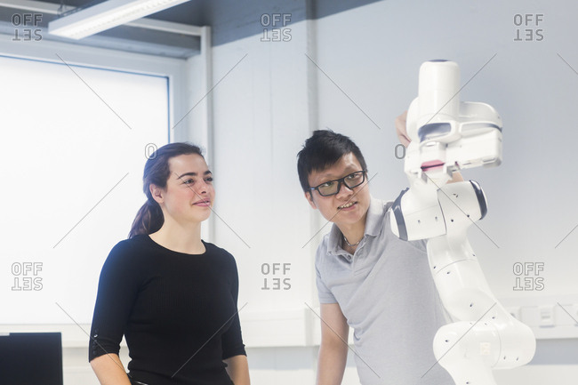 Students studying robotic at an university institute