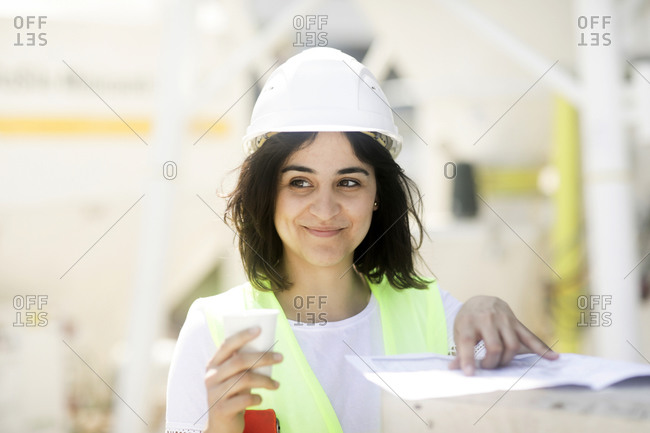 Female construction engineer during work
