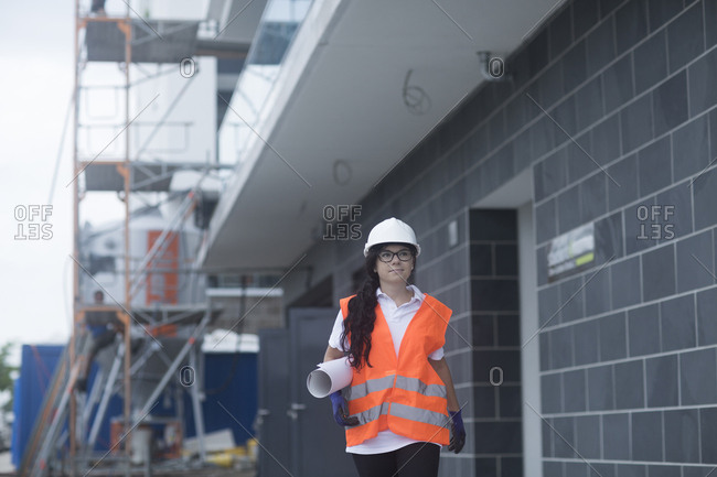 Female construction engineer checking the construction of a new house