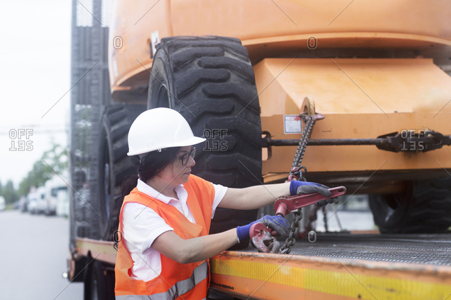 Young female construction engineer at construction site